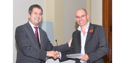 Dr Lutz Jermutus presenting the 2011 Award to Professor Derek Woolfson