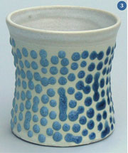 White cup with blue raised spots
