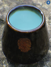 Cup with iron oxide glaze. Brown on the outside, light blue inside
