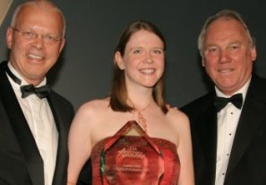 Leanne Hart receives the award from Peter Sissons on the right and Torben Jensen, MD, BASF plc on the left.