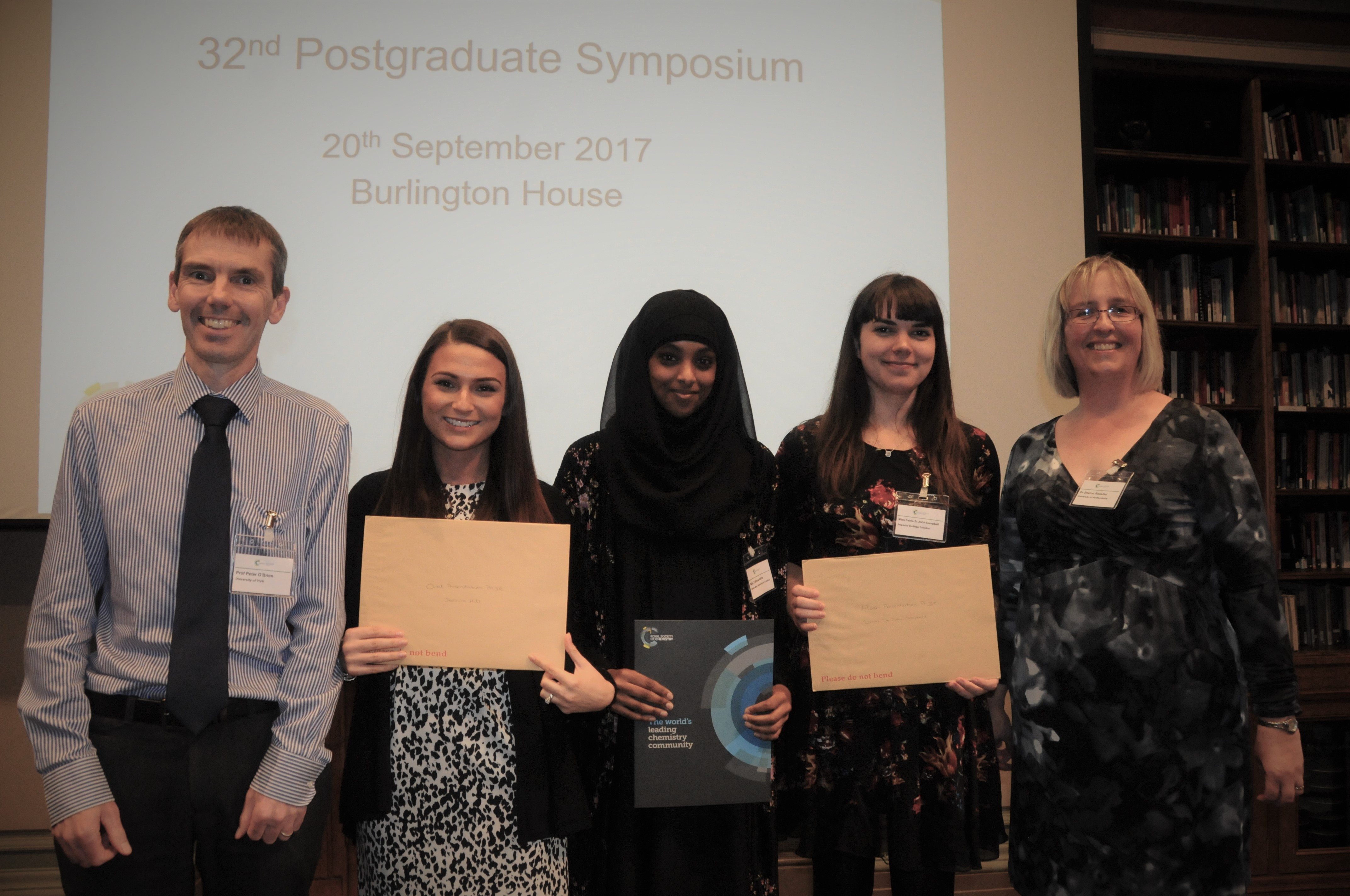 The three prize winners - Jessica Hill (University of Bristol), Fahima Idiris (Queen Mary University of London) and Sahra St John-Campbell (Imperial College London), flanked by the current Chair (Professor Peter O'Brien) and Secretary (Dr Sharon Rossiter).