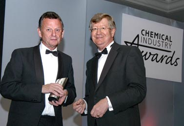 Simon Campbell receives his award from Geoff Dann, CIA President