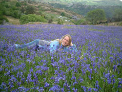 Vera Thoss lying in bluebell field