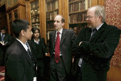 Lord Adonis (centre) and Bill Bryson talk to pupils from Kingsbury School, Brent, London