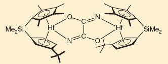 The hafnocene complex allows the CO to be inserted into the strong N-N bond