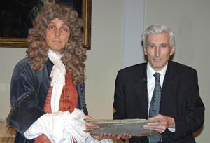 'Robert Hooke' handing over his papers to Lord Rees of Ludlow, The Royal Society's President