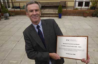 William Perkin's great-grandson Michael Kirkpatrick with a commemorative plaque at Sudbury Neighbourhood Centre