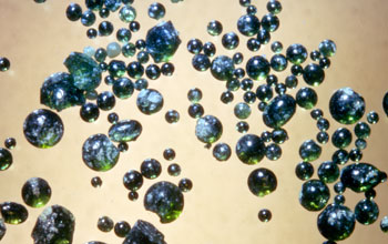 green volcanic glass beads