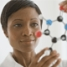Teacher holding up molecule model